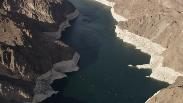 Aerial View of the Hoover Dam, Colorado River And Mountains