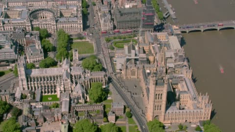 aerial view of the houses of parliament and westminster abbey, london, uk. 4k - parliament building stock videos & royalty-free footage