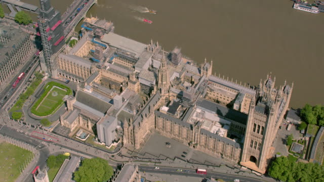 aerial view of the houses of parliament and westminster abbey, london, uk. 4k - westminster abbey stock videos & royalty-free footage