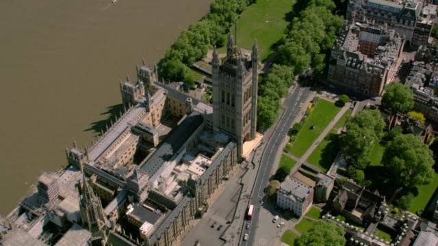 aerial view of the houses of parliament, london, uk. 4k - parliament building stock videos & royalty-free footage