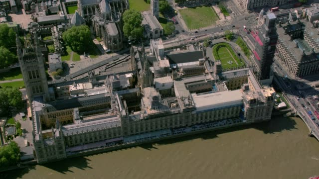 aerial view of the houses of parliament, london, uk. 4k - house of commons stock videos & royalty-free footage