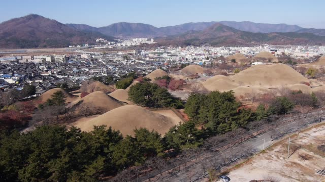 aerial view of the hwangnam daechong (great tomb of hwangnam during the silla kingdom) and the traditional village in gyeongju - gyeongju stock videos & royalty-free footage