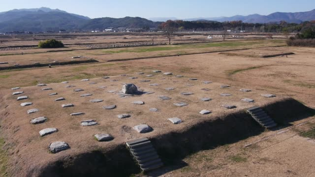 aerial view of the hwangnyongsa temple site(it was the nation's largest temple during the silla era) in gyeongju - gyeongju stock videos & royalty-free footage