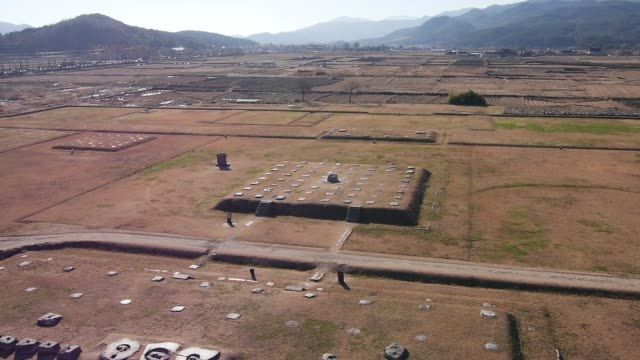 aerial view of the hwangnyongsa temple site(it was the nation's largest temple during the silla era) in gyeongju - gyeongju stock videos and b-roll footage