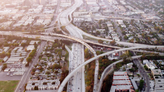 aerial view of the I405 and I10 freeway intersection, one of the original 'spaghetti junctions', RED R3D 4K, 4K, 4KMSTR