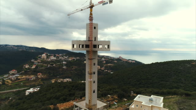 Aerial view of the Ijdabra Cross under construction and nearby coastline in northern Lebanon