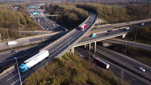 aerial view of the intersection of m1 and m25 motorways just north of london. - articulated lorry stock videos & royalty-free footage