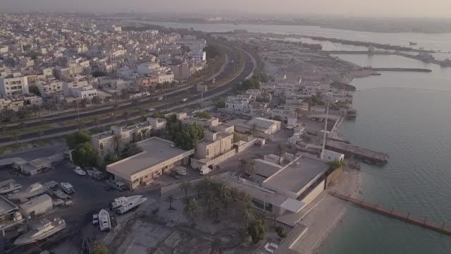 aerial view of the island of muharraq. - ペルシャ湾点の映像素材/bロール