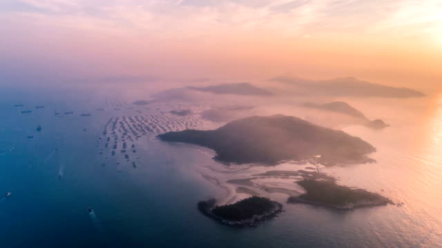 aerial view of the island - time lapse - cirrocumulus stock videos & royalty-free footage