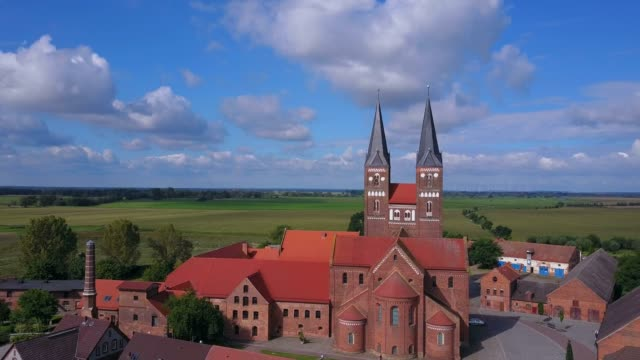 aerial view of the jerichow abbey, jerichow, jerichower land, altmark, saxony-anhalt, germany - land stock-videos und b-roll-filmmaterial