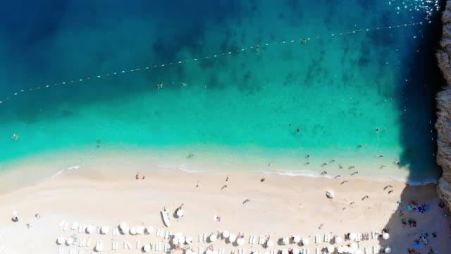 vídeos de stock e filmes b-roll de aerial view of the kaputas beach, kas - antalya, turkey - água parada