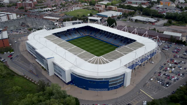 aerial view of the king power football stadium. tracking around the stadium r to l. - award stock videos & royalty-free footage
