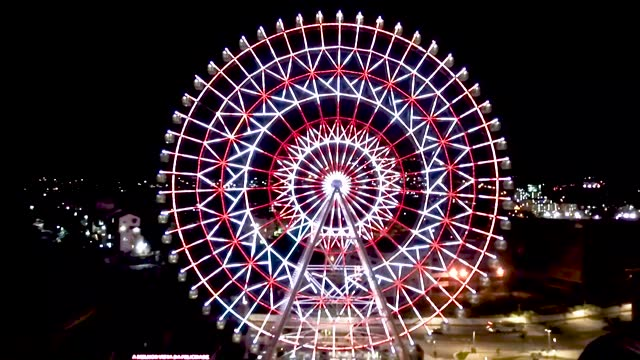 """vídeos de stock, filmes e b-roll de aerial view of the largest ferris wheel in latin america, rio star during a free lighting show with orange leds for """"orange december"""" to raise skin... - roda gigante"""