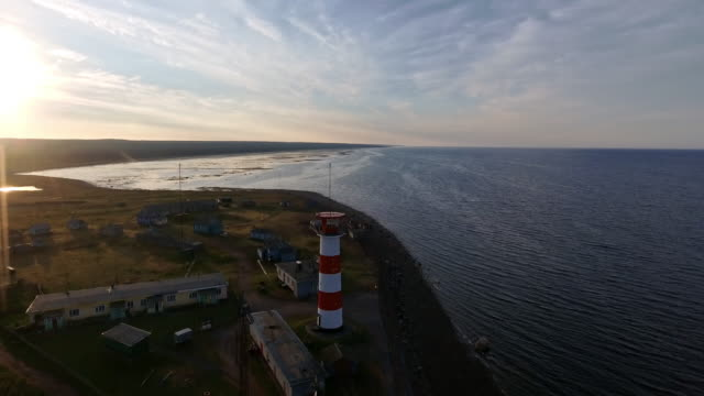 aerial view of the lighthouse on the shore of the white sea. - finlandia video stock e b–roll