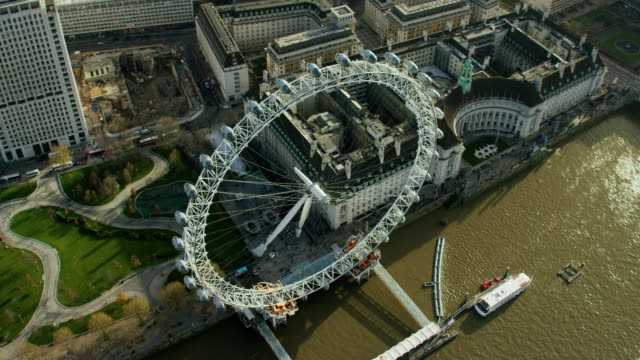 aerial view of the london eye and thames - millennium wheel stock videos & royalty-free footage