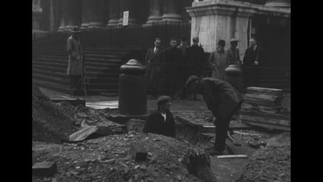 aerial view of the london skyline / vs men with shovels and pickaxes digging holes in street as they clean bomb damage after nazi bombings during... - buckingham stock videos & royalty-free footage