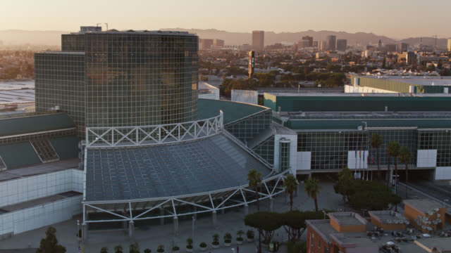 aerial view of the los angeles convention center at dusk - conference centre stock videos & royalty-free footage