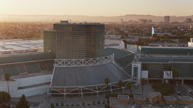 aerial view of the los angeles convention center at sunset - convention stock videos & royalty-free footage