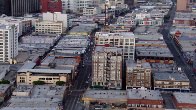 aerial view of the los angeles fashion district with the bendix building, a well known local landmark. - local landmark stock videos and b-roll footage