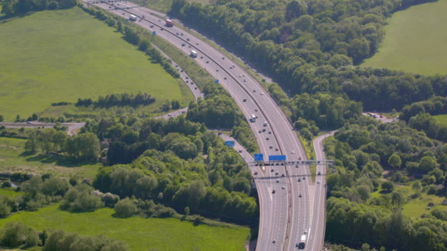 aerial view of the m25 motorway around london, uk. 4k - road sign stock videos & royalty-free footage