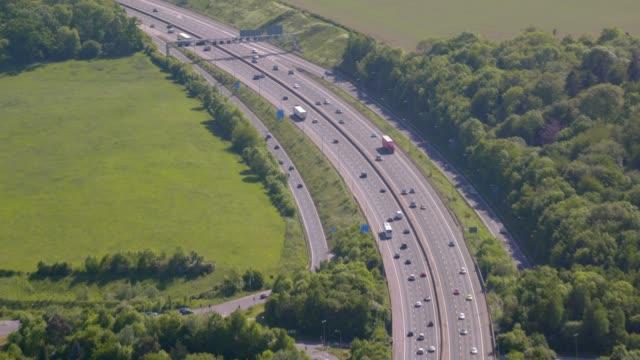 aerial view of the m25 motorway around london, uk. 4k - motorway junction stock videos & royalty-free footage
