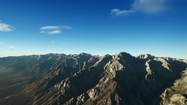 aerial view of the majestic sierra nevada mountain range. - basin and range province stock videos and b-roll footage