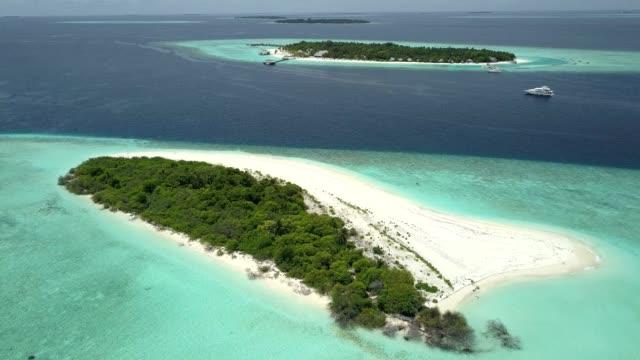 aerial view of the maldives, baa atoll. - maldives stock videos & royalty-free footage