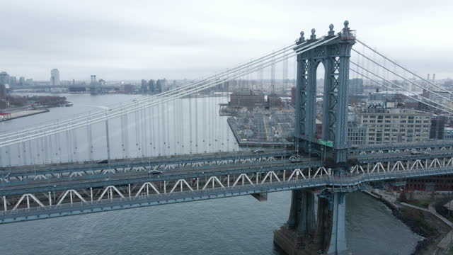 aerial view of the manhattan bridge on an overcast day - international landmark stock videos & royalty-free footage