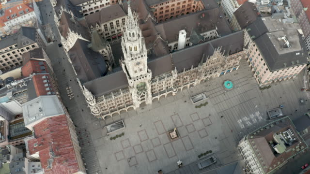 aerial view of the marienplatz beeing nearly empty following the tightening of measures affecting public life due to the coronavirus all non... - germany stock videos & royalty-free footage