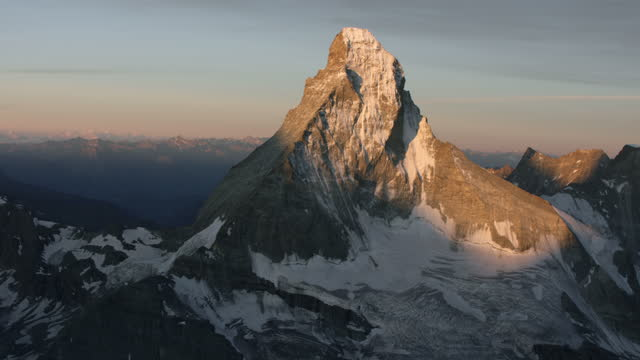 aerial view of the matterhorn in the early morning just after sunrise. - snowcapped mountain stock videos & royalty-free footage