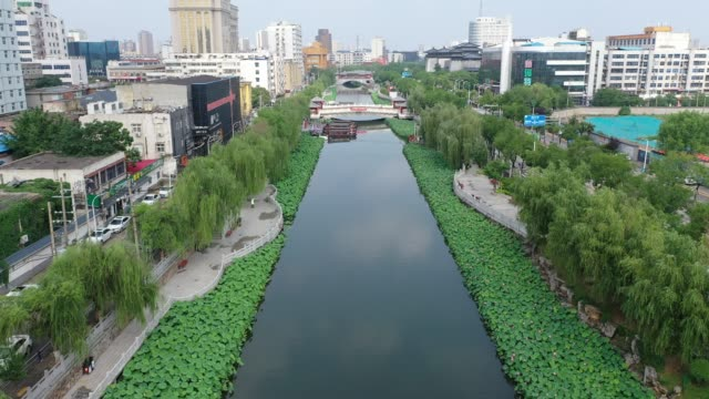 aerial view of the moat of xuchang city filled with lotus on june 18, 2020 in xuchang, henan province of china. - moat stock videos & royalty-free footage