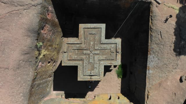 aerial view of the monolithic rockcut church of saint george dated to the late 12th amhara region lalibela ethiopia on october 30 2018 in lalibela... - ethiopia stock videos & royalty-free footage