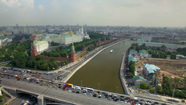Aerial view of The Moscow Kremlin embankment, Dormition Cathedral and Red Square, along Moskva River