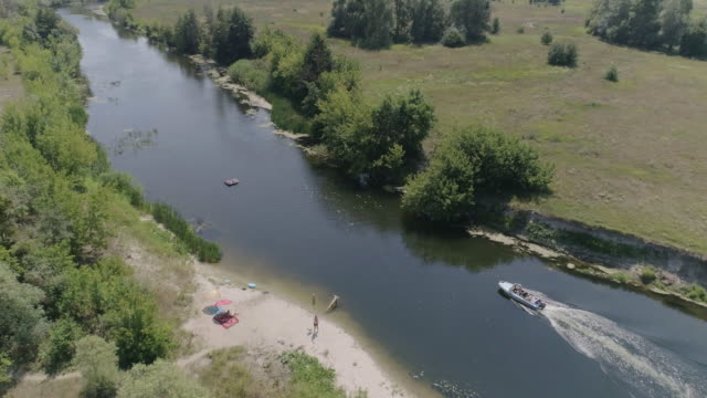 aerial view of the motorboat on the river in the meadow - ukraine stock videos and b-roll footage