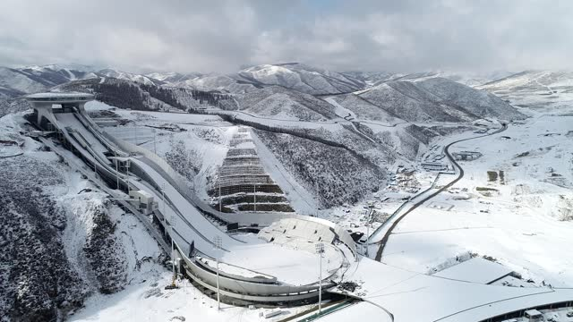 aerial view of the national ski jumping center, which is nicknamed 'snow ruyi', on march 12, 2021 in zhangjiakou, hebei province of china. - winter sport stock videos & royalty-free footage