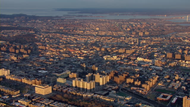 aerial view of the new york city borough of the bronx, looking east toward the long island sound. - bronx new york stock videos and b-roll footage