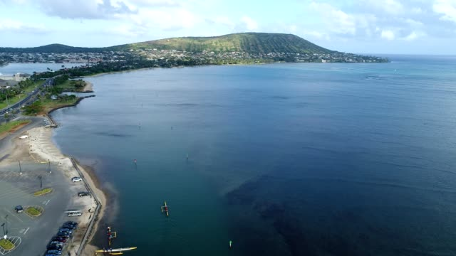 aerial view of the ocean around honolulu hawaii with a mountain in the background - honolulu stock videos and b-roll footage