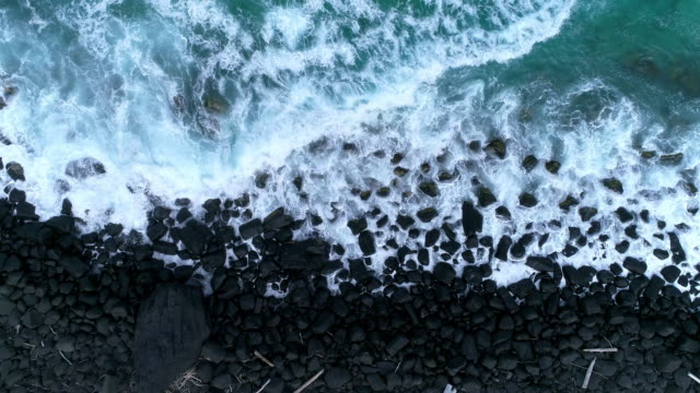 aerial view of the ocean waves hitting against the rocks - coastline stock videos & royalty-free footage