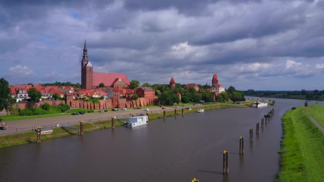 stockvideo's en b-roll-footage met aerial view of the old town of tangermnde with church st. stephen and castle, elbe river, saxony-anhalt, germany - rond de 12e eeuw