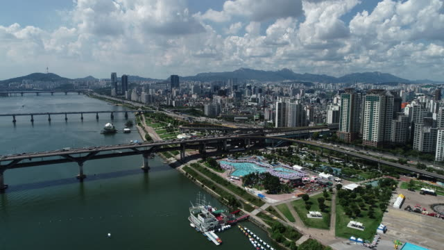 aerial view of the outdoor swimming pool in ttukseom hangang park next to the han river in seoul, south korea - seoul stock videos & royalty-free footage