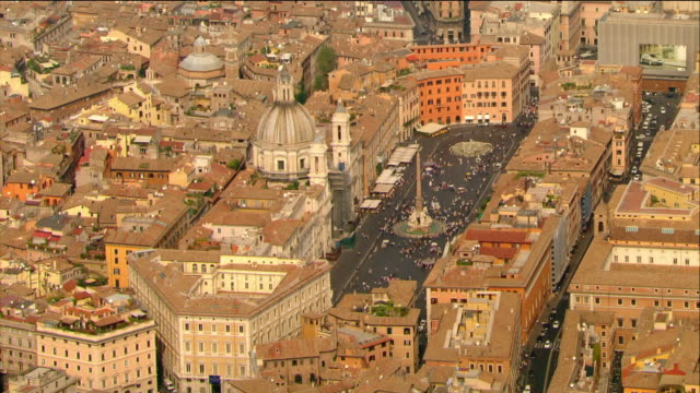 aerial view of the piazza navona and surrounding buildings / rome, italy - obelisk stock videos & royalty-free footage
