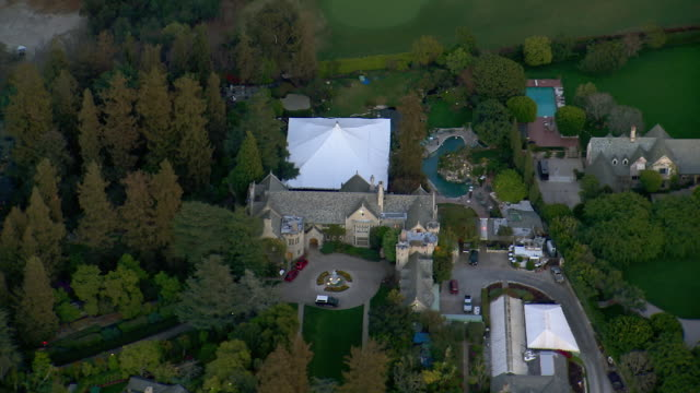 los angeles, california - march 1, 2012: aerial view of the playboy mansion, home of hugh hefner, in los angeles california. - playboy mansion stock videos & royalty-free footage