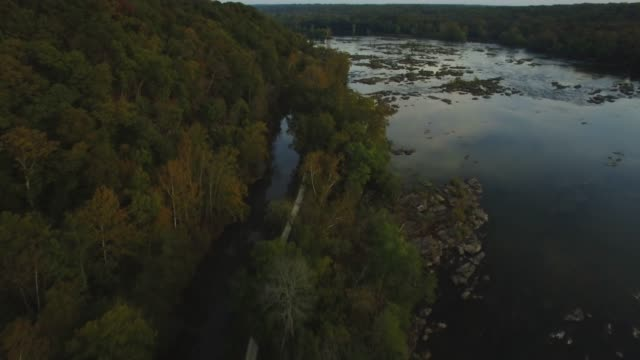 aerial view of the potomac river and c&o canal at sunset dusk in maryland - river potomac stock videos & royalty-free footage