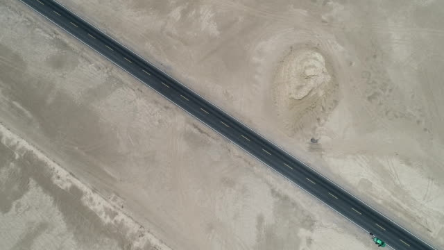 aerial view of the qaidam basin highway - tire track stock videos & royalty-free footage