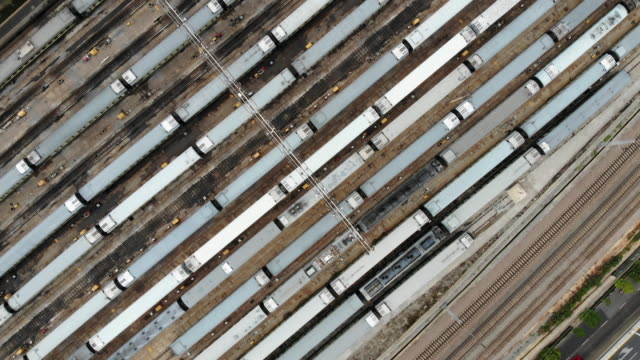 aerial view of the railway station (real time) - stationary stock videos & royalty-free footage
