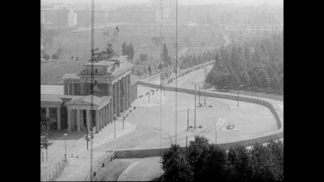 / aerial view of the Reichstag building / panning around the perimeter of the Reichstag / road leading to Reichstag Berlin Wall Reichstag building on...