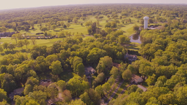 aerial view of the residential suburban area in scarsdale, a small town in westchester, new york, in a sunny summer day. drone video with the cinematic forward and panning camera motion. - stately home stock videos & royalty-free footage