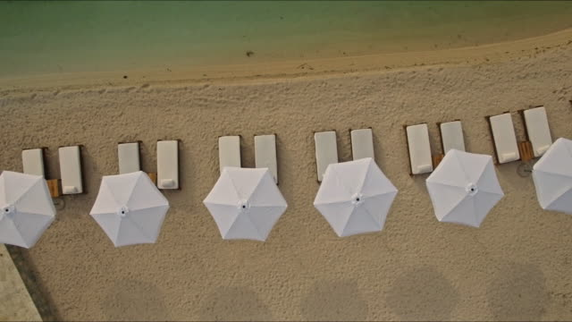 aerial view of the restaurant on the beach - beach chairs stock videos & royalty-free footage