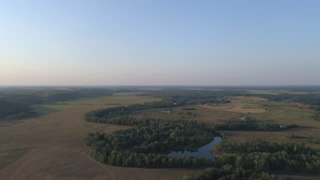 aerial view of the river in the meadows on a summer morning - ukraine stock videos and b-roll footage