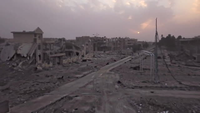 aerial view of the road leading out of raqqa syria - zerstörung stock-videos und b-roll-filmmaterial